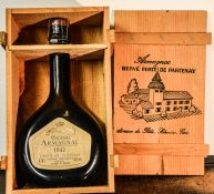 A bottle of Grand Armagnac, 1942, 70cl, in the original presentation crate.