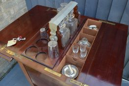 A Stewart Dawson & Co of Hatton Gardens mahogany liquor cabinet, complete with glasses and