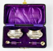A pair of silver salts, London 1901 by George White, in the original purple velvet and silk lined