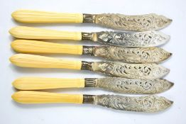 A set of six silver fish knives with bone handles, the knives engraved with fish.