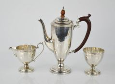 A silver three piece coffee set.