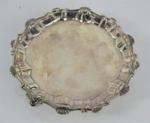 A George III Sterling silver waiter with gadrooned borders raised on three feet by Elizabeth