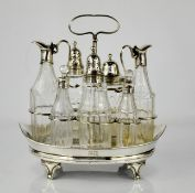 A George III silver and glass condiment set, by Robert Hemmel, with a boat shaped stand, standing on