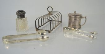 A silver toast rack, Birmingham 1968 together with a silver mustard pot, and two silver sugar tongs.