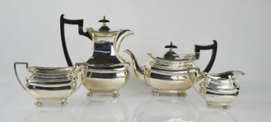 A silver tea service comprising tea pot, hot water pot, sugar bowl and milk jug, Sheffield 1964,