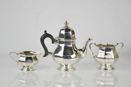A three piece Edward VII silver tea service by Henry Matthews, Birmingham 1906, of octagonal form,