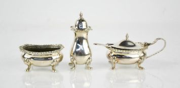 A silver cruet set comprising mustard pot, salt, and pepper shaker, 3.85toz.