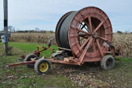 "Irrigation/manure reel w/ 1000± feet of 4"" hard hose on trailer, Big Gun head w/ motor and"