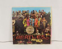 Beatles 'Sgt Pepper' LP, US pressing, with flame inner and insert and rainbow rim label. Without the