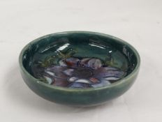 Moorcroft Pottery Anemone pattern circular footed dish with green ground. 11.5cm dia, paper label