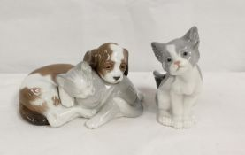Lladro porcelain figure group of a puppy and kitten, 10cm high and another of a cat, 14cm (2)