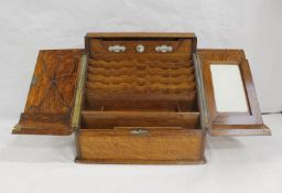 Victorian oak stationery cabinet, the hinged doors to sloping front opening to fitted tiered