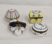 Four Continental porcelain boxes of various forms, each with floral decoration