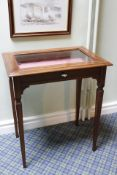 Walnut vitrine table, inlaid banding and square tapered supports.