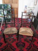 Arts & Crafts style ladder back low armchair, c1900, with rush seat, and a similar side chair. (2).