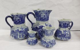 Set of five reproduction blue and white Ironstone jugs. the largest 24cm, smallest 10cm