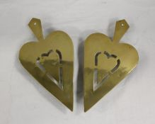 Pair of brass trivets, each of pierced spade shape and another. (3)