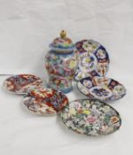 Modern Oriental ginger jar and cover, four Imari plates and another floral decorated (6)