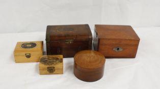 Two Mauchline ware boxes, wooden music box, money box, key box and an oak circular box. (7)