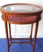 Oval mahogany vitrine table on square tapered splay supports and understretchers, 59cm wide.