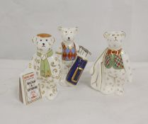 Three Royal Crown Derby teddy bear figures, Newspaper seller bear, Christmas 2102 and Ryder Cup 2014