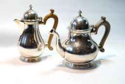 Silver teapot of pear shape, and a hot water pot, crested, by C.S. Harris & Sons, 1925/6, 22oz.