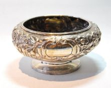 Irish silver sugar bowl of compressed circular shape, embossed with flowers upon matting, maker