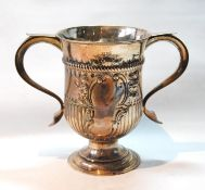Silver two-handled cup, embossed in the manner of early 18th century, probably Thos. Wynne, 1776,