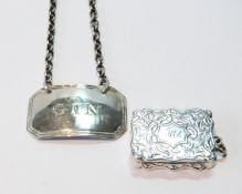 Silver engraved vinaigrette by F. Marston, in two parts, and a spirit label, by Unite and