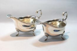 Pair of silver sauce boats with gadrooned edges, on scallop and pad feet, 1938, 6oz.