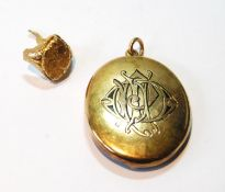 Gold oval locket, monogrammed, probably 15ct, 11g, and a broken signet ring, probaby 18ct, 6g.