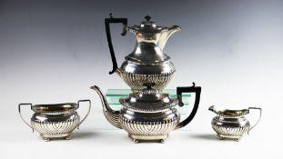 An Edwardian four piece silver tea service by Joseph Gloster Ltd, Birmingham 1907/08, comprising