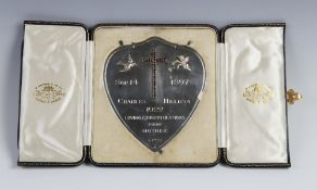A George V silver plaque by Goldsmiths & Silversmiths Co, London 1922, the shield shaped plaque