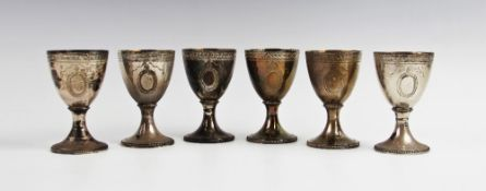 A set of six silver gilt goblets by CJ Vander, London 1973, of typical form on circular spreading