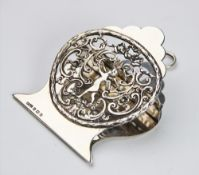 An Edwardian silver desk paperclip by Grey & Co, Birmingham 1908, with a pierced central panel