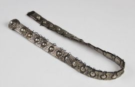 A late 19th century Russian silver belt, each link with embossed floral decoration with a circular