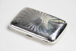 An Edwardian silver cigarette case by Cornelius Desormeaux Saunders & James Francis Hollings