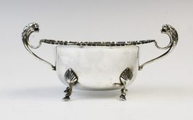 A George V twin-handled silver sugar bowl by E Hill, Birmingham 1934, of oval form with shaped