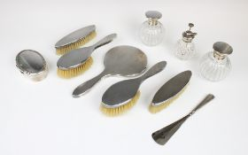An Art Deco Britannia standard silver backed dressing table set by British Metallising Co Ltd,