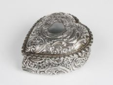 A Victorian heart shaped silver box by William M Hayes, Birmingham 1897, with embossed scrolling