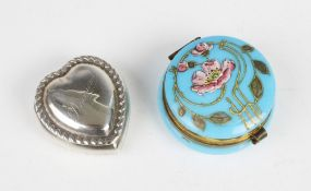 A Victorian silver heart shaped pill box, the hinged cover with reeded border and inscription '