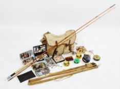 A collection of fly fishing equipment, comprising: a 'The Pope Palakona' two piece split cane
