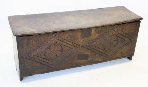 A mid 17th century oak six plank sword chest/coffer, the hinged cover with a moulded border