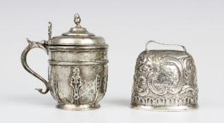 A 19th century continental silver cow bell, of tapering oval form with embossed scrolling