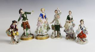 Three pairs of Sitzendorf porcelain figures, comprising; a pair of flower pickers, on gilt lined