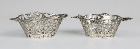 A pair of Edwardian Continental silver miniature twin handled baskets, each of oval form with shaped