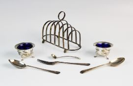 A silver six-division toast rack by E J Houlston, Birmingham 1946, of oval form with seven graduated