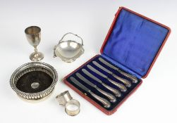 A selection of silver and white metal tableware, to include an Edwardian boxed shell form butter