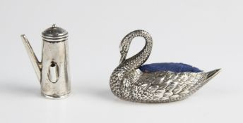An Edwardian novelty silver pin cushion in the form of a swan by Adie & Lovekin Ltd, Birmingham