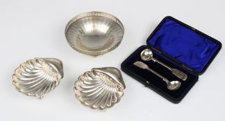 A pair of Edwardian silver shell form butter dishes by Atkin Brothers, Sheffield 1905, each raised